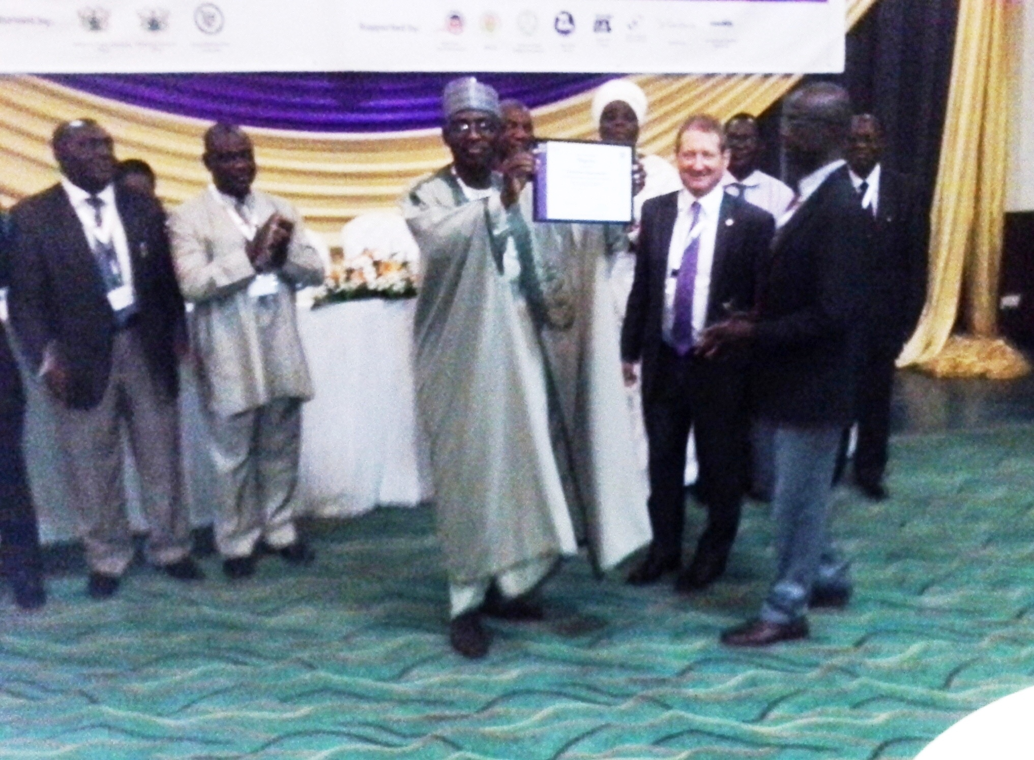 maj-gen-ut-usman-rtd-nat-president-ciltn-displaying-the-territorial-organization-certificate-to-delegates-the-forum