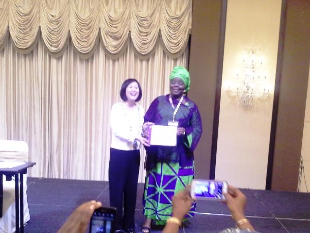 Presentation of d Int'l President's Medal to Global Convener-Founder WiLAT, Hajia Aisha Ali-Ibrahim, FCILT by Dr. Dorothy Chan, FCILT, CILT Int'l President
