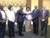 CILT Nig President Maj Gen UT Usman (Rtd) presenting an award to Rep of H.E. Gov of Plateau state