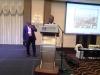 Mr. Yakubu Jang making a presentation on behlaf of d Gov of Plateau state, H.E. Gov Jonah Jang & behind is d Perm Sec MOT, Plateau