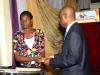 R - Maj Gen UT Usman (Rtd), FCILT, Nat'l President CILTNig presenting cash prize to one of d winners of d debate