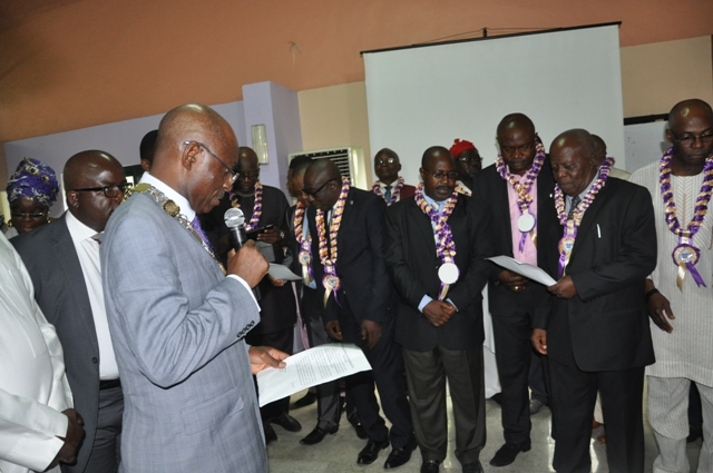 Nat'l President, CILTN administering the oath of membership to cross section of d newly Elected Chartered Fellows, FCILT