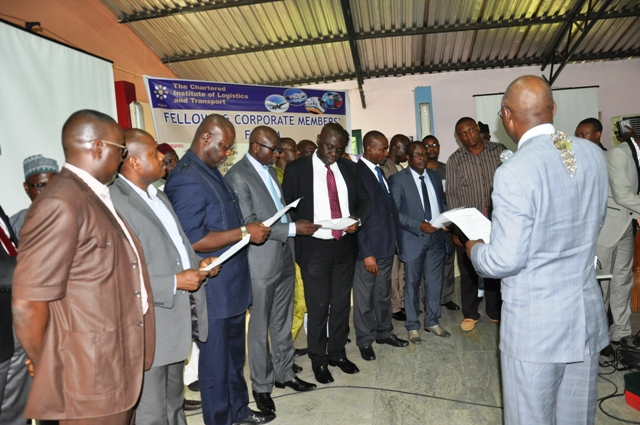 Nat'l President, CILTN administering the oath of membership to cross section of d newly Elected Chartered Members, CMILT