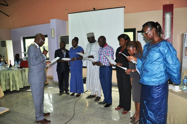 Nat'l President, CILTN administering the oath of membership to cross section of d newly Elected Members, MILT