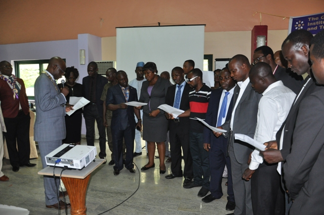 Nat'l President, CILTN administering the oath to cross section of d newly Graduating Professional Students