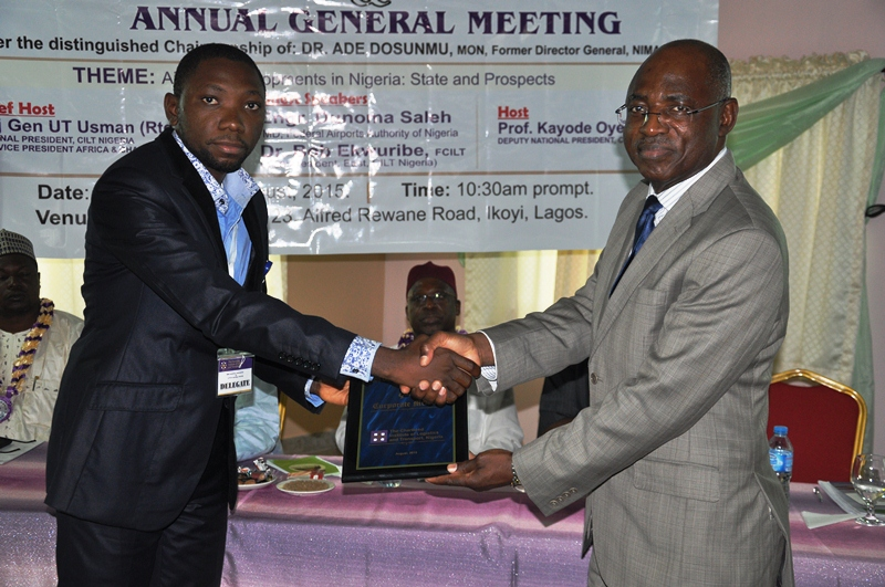 R- Maj. Gen UT Usman (Rtd), FCILT (Nat'l President CILT, Nig) during the presentation of plague to newly registered Corporate Member