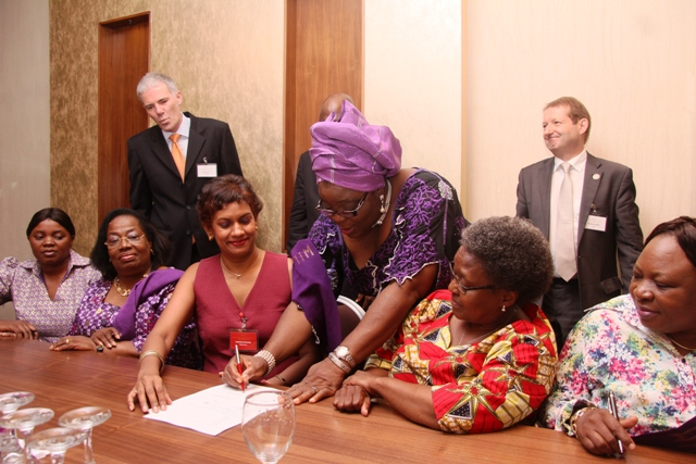 Founder & Global Convenor of WiLAT, Mrs. Aisha Ali-Ibrahim, signing the WiLAT Constitution