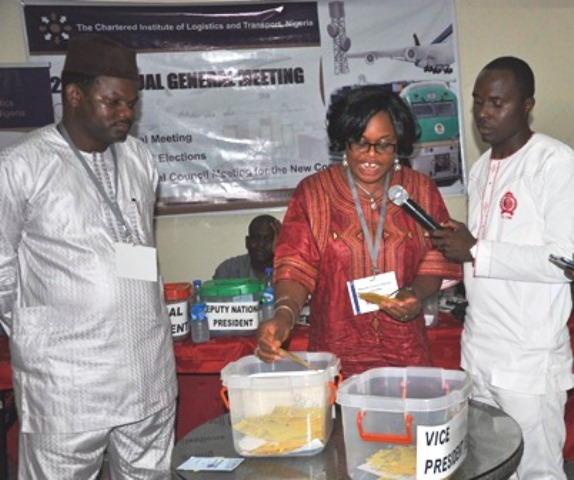L-R Dr. Ade Dosumu (Chairman,Election Committee of the Institute), Mrs. Margaret Ogbonnah (Member, Election Commtt) during the counting of votes