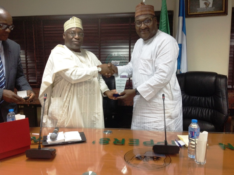 National President, CILT, Nigeria, Mr. Ibrahim Jibril presenting an award to the Executive Secretary-CEO of Nigerian Shippers' Council, Mr. Hassan Bello during the courtesy visit