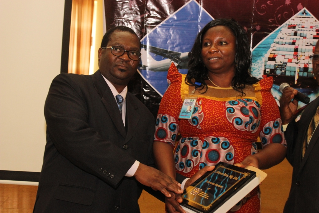 Presentation of Corporate Membership plaque to E.Ekeson Bros Nig Ltd