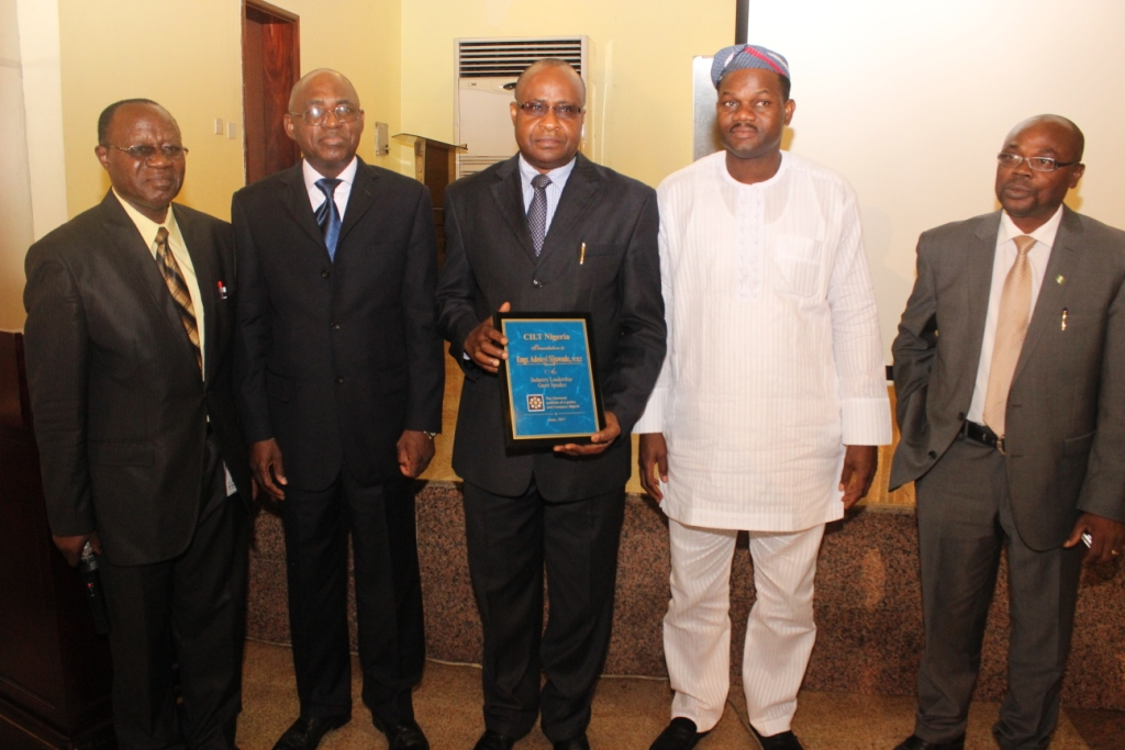Presentation of plaque to Engr. Seyi Sijuwade, MD, NRC represented by Mr. John Dottie (DD, Corporate Planning, NRC)