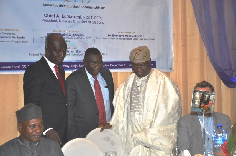 Chairman of Event, Chief Adebayo Sarumi, FCILT, OFR being welcomed to the high table by the Deputy Nat'l President of CILTN, Prof. Kayode Oyesiku, FCILT