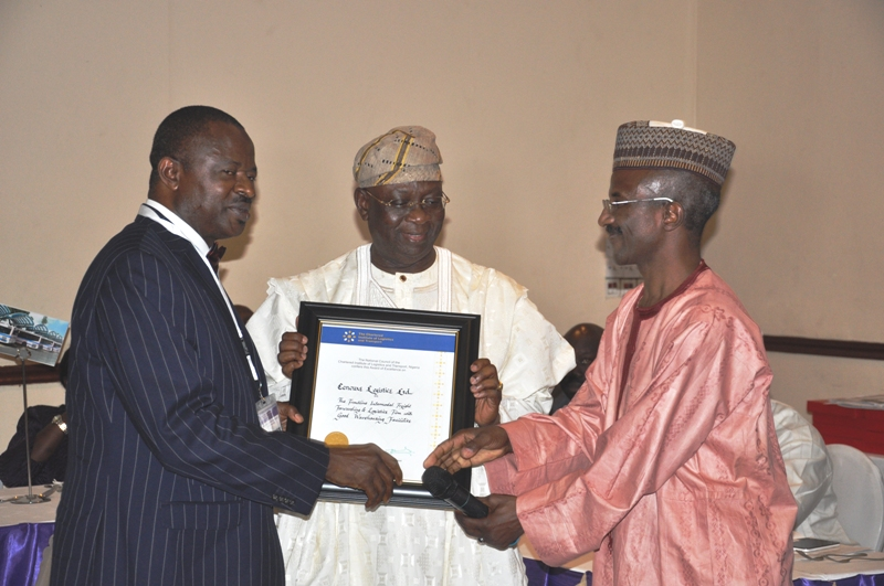 Chairman of Event, Chief Adebayo Sarumi, FCILT, OFR (middle) presenting an award certificate to Sir. Chima P. Ubechu, CEO, Cenouxs Logistics Ltd (L)