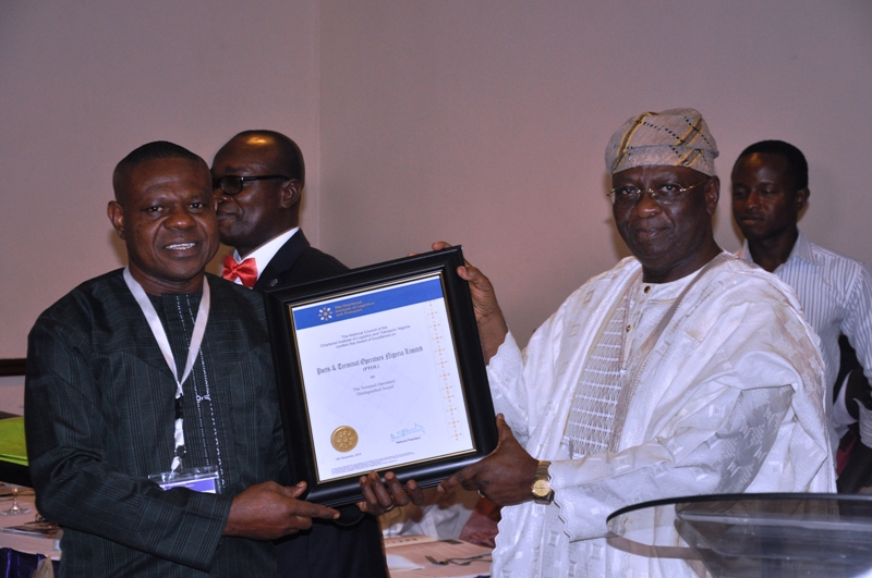 Chairman of Event, Chief Adebayo Sarumi, FCILT, OFR presenting an award to Port & Terminal Operators Nigeria Ltd
