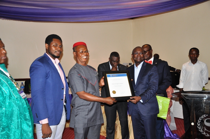 Dr. Mobereola Ekundayo, FCILT, Hon. Commissioner for Transportation, Lagos State presenting an award to Chisco Transport Company