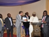 Chairman of Event, Chief Adebayo Sarumi, FCILT, OFR presenting an award to SIFAX Group